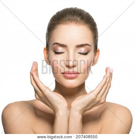 Beautiful face of young caucasian woman with  health skin  - isolated on white.  Skin care concept. Female Model touches face.