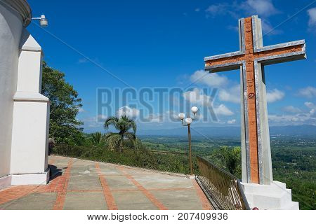 SANTO CERRO, DOMINICAN REPUBLIC - NOVEMBER 05, 2012: Modern cross overlooking the valley of Cibao next to the Church of Our Lady of Mercedes in Santo Cerro, Dominican Republic.