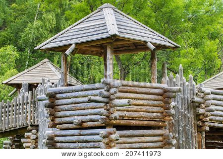 Medieval wooden castle, fortification in summer day