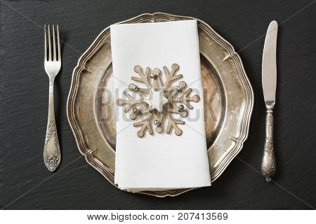 Christmas Table Setting With Vintage Dishware, Silverware And Snowflake Decorations.
