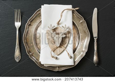 Christmas Table Setting With Vintage Dishware, Silverware And Deer Decorations.