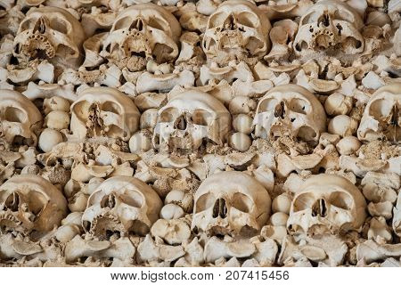Human skulls and bones in the wall of the Capela dos Ossos (Chapel of Bones). Igreja do Carmo church. Faro Algarve Portugal