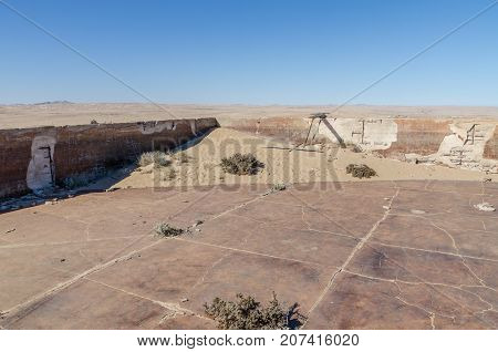 Abandoned swimming pool at ruins of once prosperous German mining town Kolmanskop in the Namib desert near Luderitz, Namibia, Southern Africa.