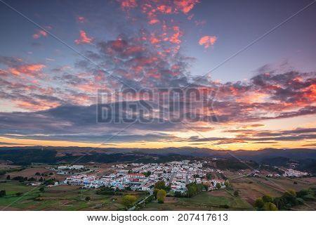 Magical sunrise over the village of Aljezur. Portugal