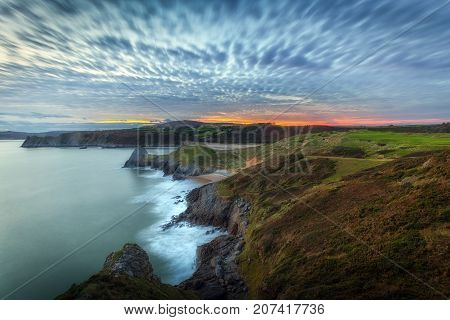 Blue hour at Three Cliffs Bay Quilted clouds and a blue hour sunset at Three Cliffs Bay on the Gower peninsula, Swansea, South Wales, UK