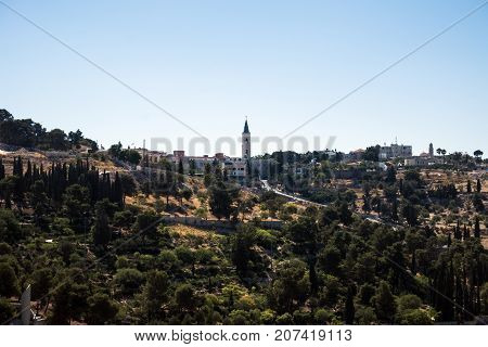 The Mount of Olives. Among other buildings can be seen the tower of the Temple of the Ascension (Jerusalem, Israel)