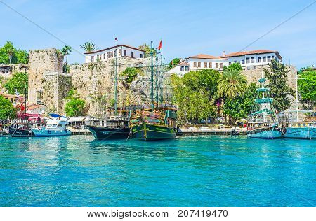 ANTALYA TURKEY - MAY 12 2017: The scenic old marina of resort with yachts pleasure boats and replicas of medieval galleons ready for the daily trips on May 12 in Antalya.