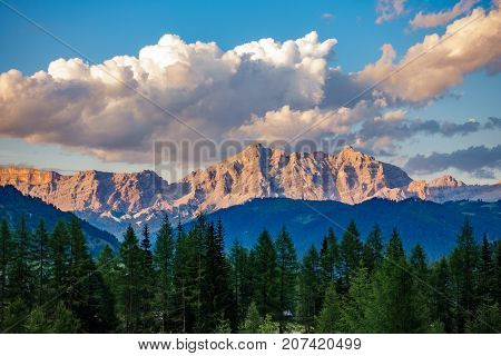 Long shot of dolomite rock mountains at dusk, Italy