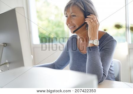 Senior sales representative working in office