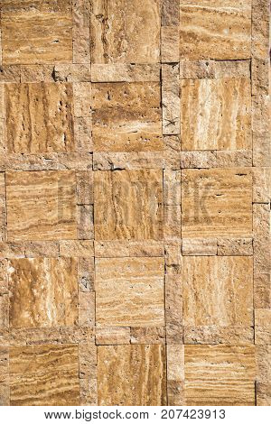 Decorative cubic stone wall as background texture