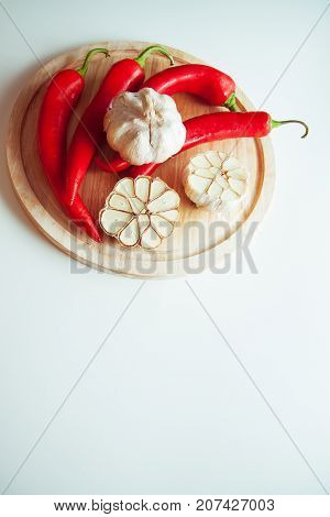 vegetables for flavouring: peppers and garlic on plate