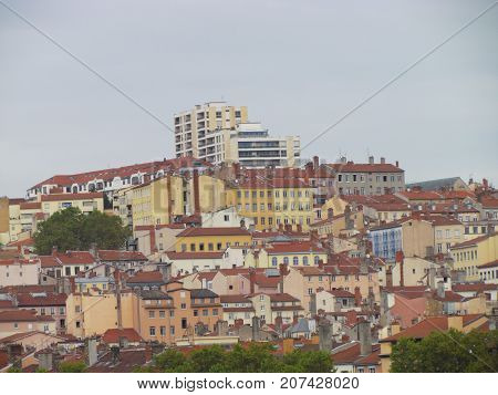 Cityscape view on top hill La Croix-Rousse ginger cross neighborhood of Lyon France with colorful houses and buildings