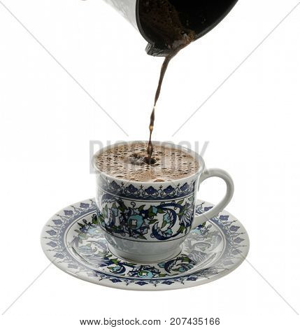 Pouring Turkish Coffee over white background.