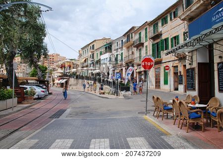 MAJORCA, SPAIN - SEPTEMBER 6, 2017: Tram tracks along the seafront road at Port de Soller on the Spanish island of Majorca. The West coast town is a popular tourist destination.