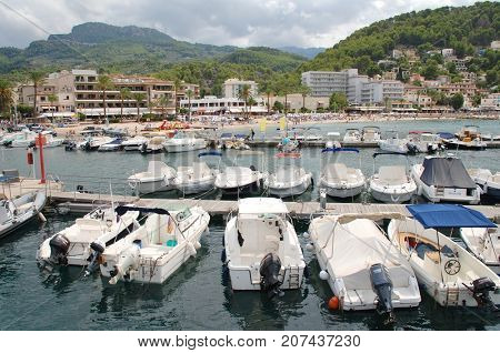 MAJORCA, SPAIN - SEPTEMBER 6, 2017: Boats moored in the harbour at Port de Soller on the Spanish island of Majorca. The West coast town is a popular tourist destination.
