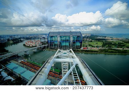SINGAPORE-26 Aug 2017. Singapore flyer cabin high up in the sky. Singapore flyer one of the biggest ferris wheel in the world a tourist attraction overlooking Marina Bay.