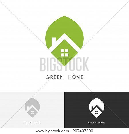 Green home logo - house with window and chimney on the roof and fresh leaf symbol. Greenhouse, ecology and real estate vector icon.
