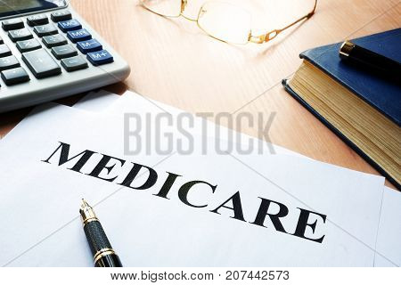 Medicare policy on a desk. Health insurance concept.