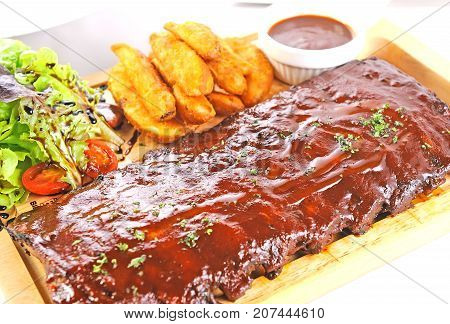 delicious BBQ Ribs with tomato and salad