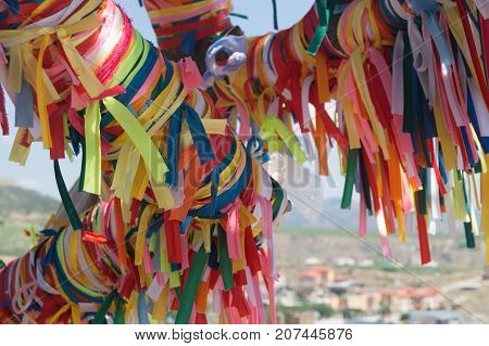Wish tree with colorful decorated tapes. Make a wish concept.