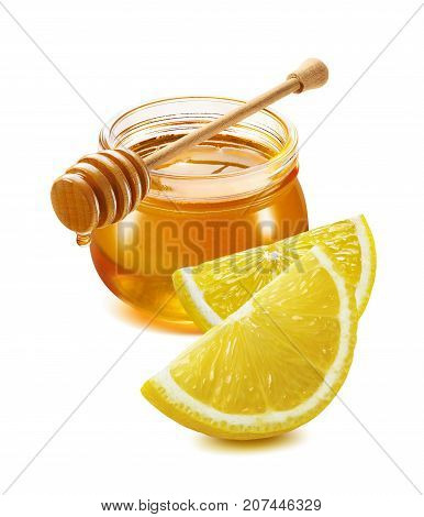 Remedy for flu and cold - honey jar lemon quarters isolated on white background