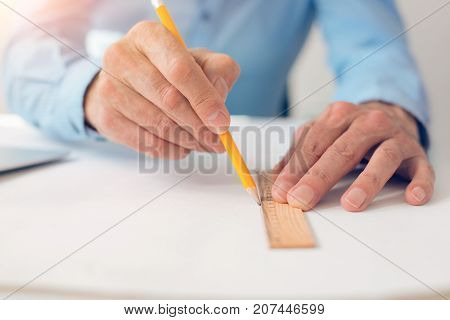 Pencil and ruler. Close up of a drawing tools being used by a nice professional skillful engineer while drawing