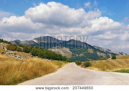 Geometric landscape. Lines of the road and triangles of the mountain pattern. Balkans. Montenegro, Krnovo - near Niksic town