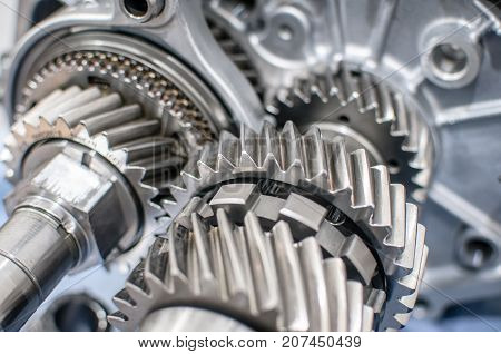 silver shiny transmission gears of a motor