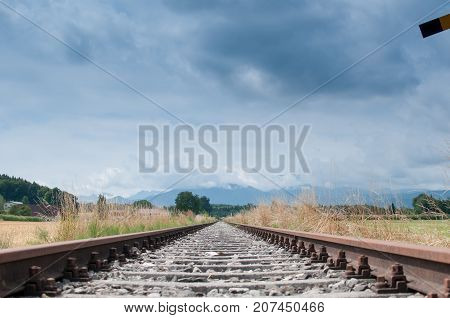 old rail tracks with coudy sky - low perspective