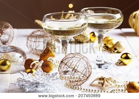 glasses of wine/ glasses of wine on the background of Christmas decorations. Christmas decorations with martini glasses. Christmas and New Year celebration with champagne.