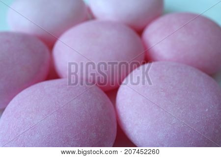 Lined up Pastel Purple Sugar Coated Round Candies, Macro Shot for Texture and Background with Selective Focus