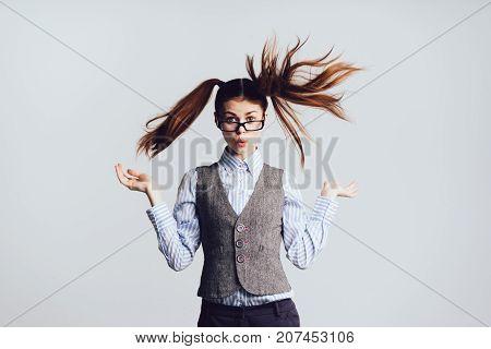 girl secretary in glasses with surprised gesture