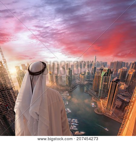 Arabian Man Is Watching Dubai Marina In Dubai, United Arab Emirates.