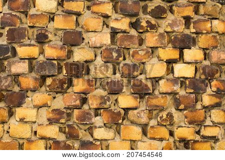 The old brickwork of the old building is made of yellow brick.
