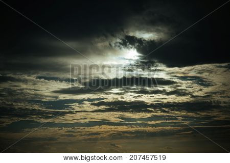 Evening sky with dark clouds at sunset on natural background. Nature environment weather and climate. Disaster and danger concept