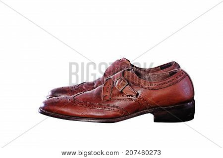 Closeup of Second hand Fashionable Male Classic Leather Shoes isolate on white background.