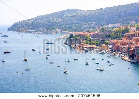 Beautiful daylight view to boats and ships on water in luxury resort villefranche sur mer and bay on french riviera at mediterranean sea Cote d'Azur in France.