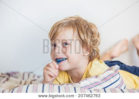 Three-year Old Boy Shows Myofunctional Trainer To Illuminate Mouth Breathing Habit. Helps Equalize T