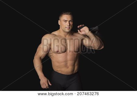 Strong Man With Sports Bag on Black on Black Background