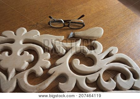 Cutting wood carving. House carving. Volumetric-convex shape. Alder.