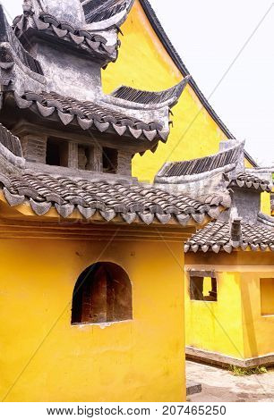 Golden colored Chinese style buildings at the Seventh Master Temple in Xitang Town in Jiashan county Zhejiang Province China.