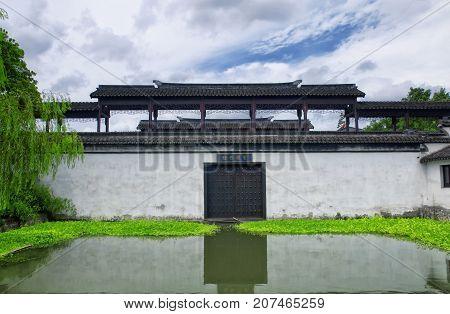Yingxiu Bridge near water in Xitang town in jiashan county in Zhejiang Province China on an overcast sunny day.