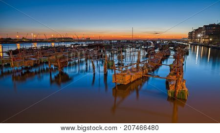 Chioggia, Venice, Italy: night landscape of the bay with wooden poles and crates for clams breeding