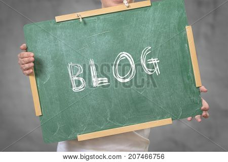 BLOG text written on chalkboard. Blogging concept.