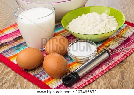 Ingredients For Preparing Pancakes, Empty Bowl And Whisk