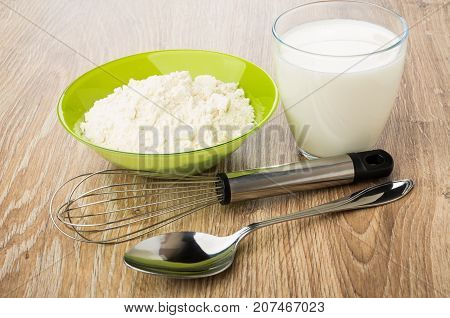 Flour In Green Bowl, Glass Of Yogurt, Spoon And Whisk
