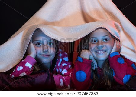 Kids Wearing Red Jammies In Bed On Black Background