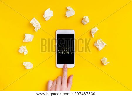 Top view of a woman hand using phone on which is written - take your idea