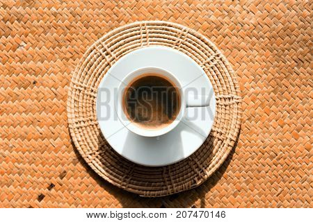Coffee in white coffee cups placed on natural basketry.