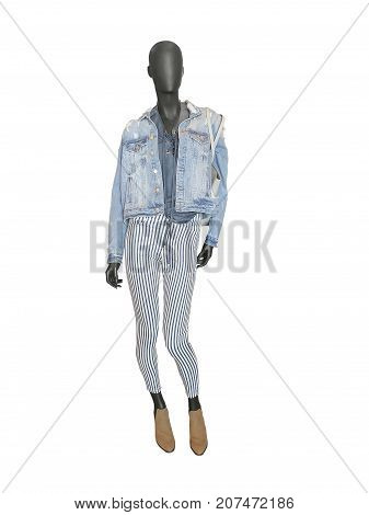 Full-length female mannequin dressed in jeans jacket and stripped trousers isolated on white background. No brand names or copyright objects.